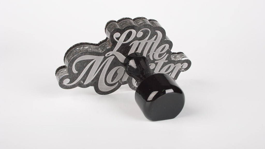 Custom traditional rubber stamp commercial with wooden handle.